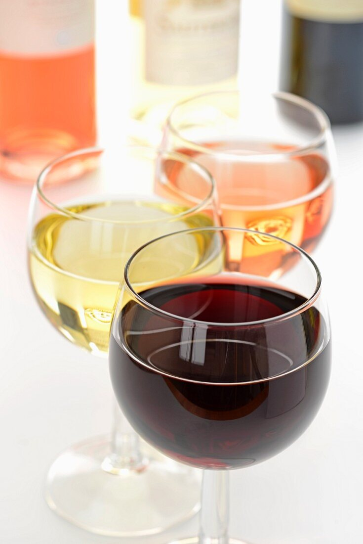 Glasses of rose, white and red wine