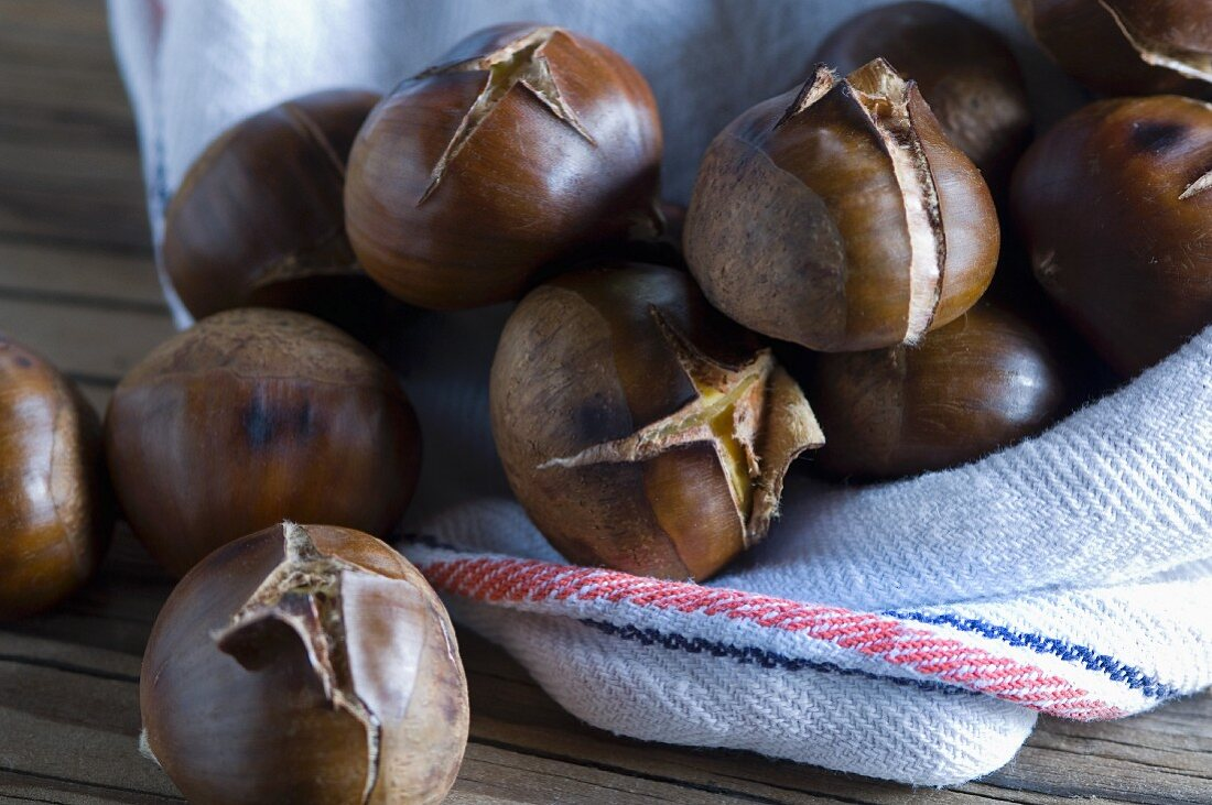 Roasted chestnuts on a tea towel