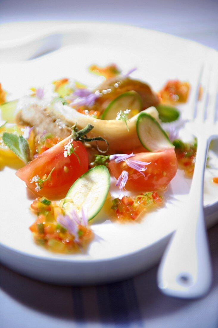 An aubergine, courgette and tomato caviar salad