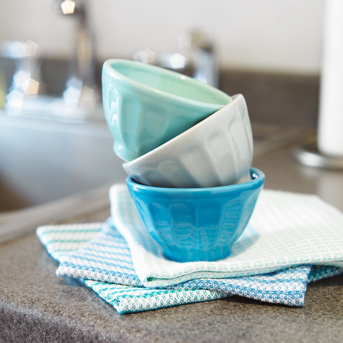 Small Prep Bowls Stacked on Kitchen Towels on a Kitchen Counter