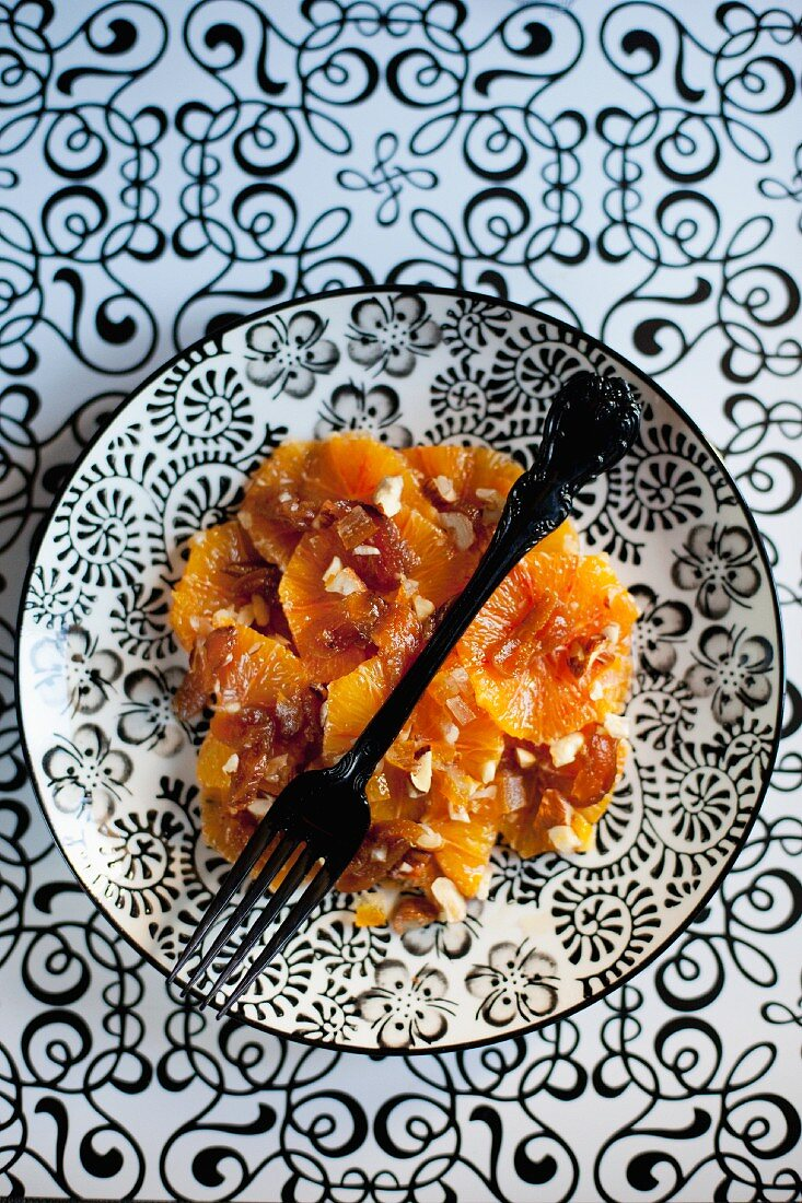 Orange and apricot salad with hazelnuts and maple syrup