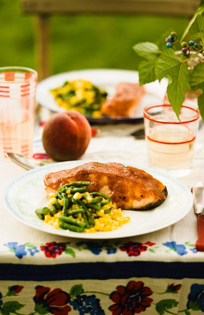 Outdoor Table Set with Peach Glazed Salmon with Corn and Beans