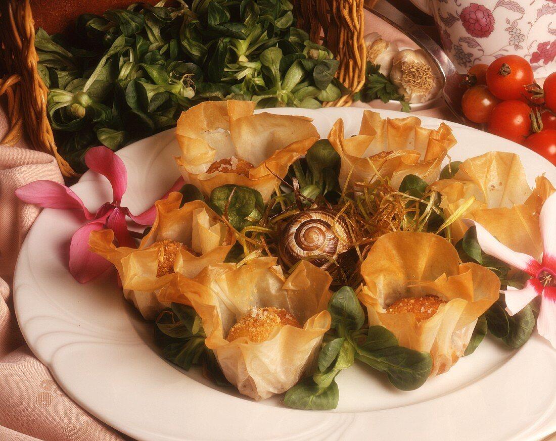 Beignets di lumache (snail fritters in a filo pouch)