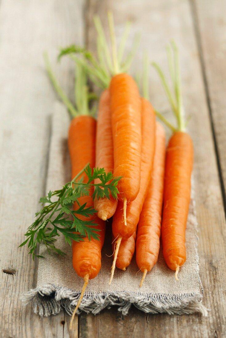 Fresh carrots on linen cloth