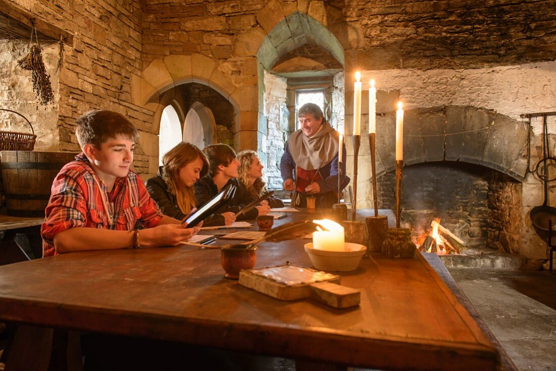 Pupils and a teacher in an old fortified castle