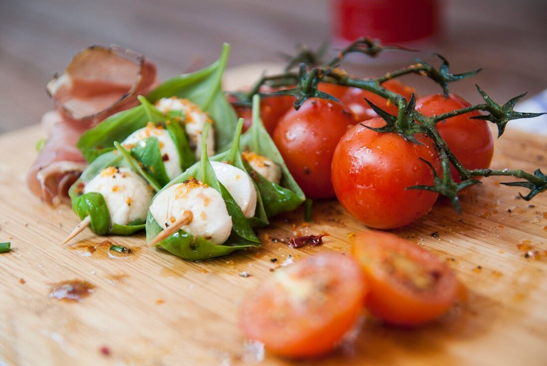 Tomatoes with mozzarella and basil skewers