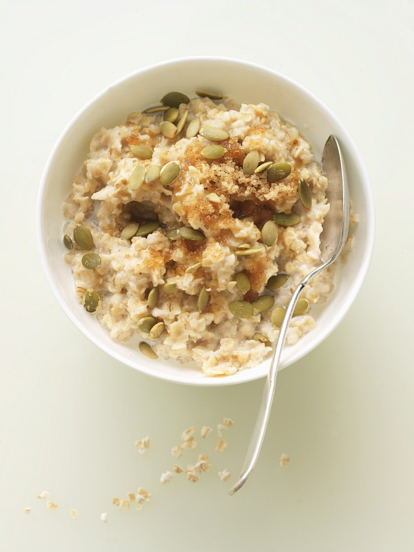 Bowl of Gluten Free Oatmeal with Pumpkin Seeds, Brown Sugar and Cream; From Above
