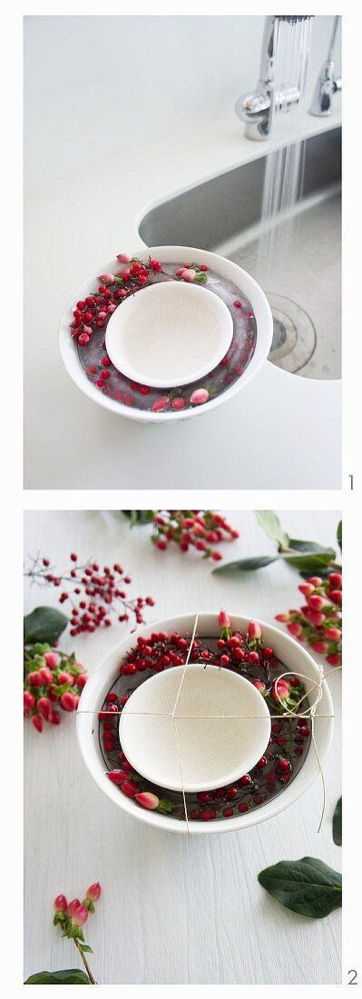 An ice bowl being prepared; the ice contains hypericum and Skimmia japonica berries