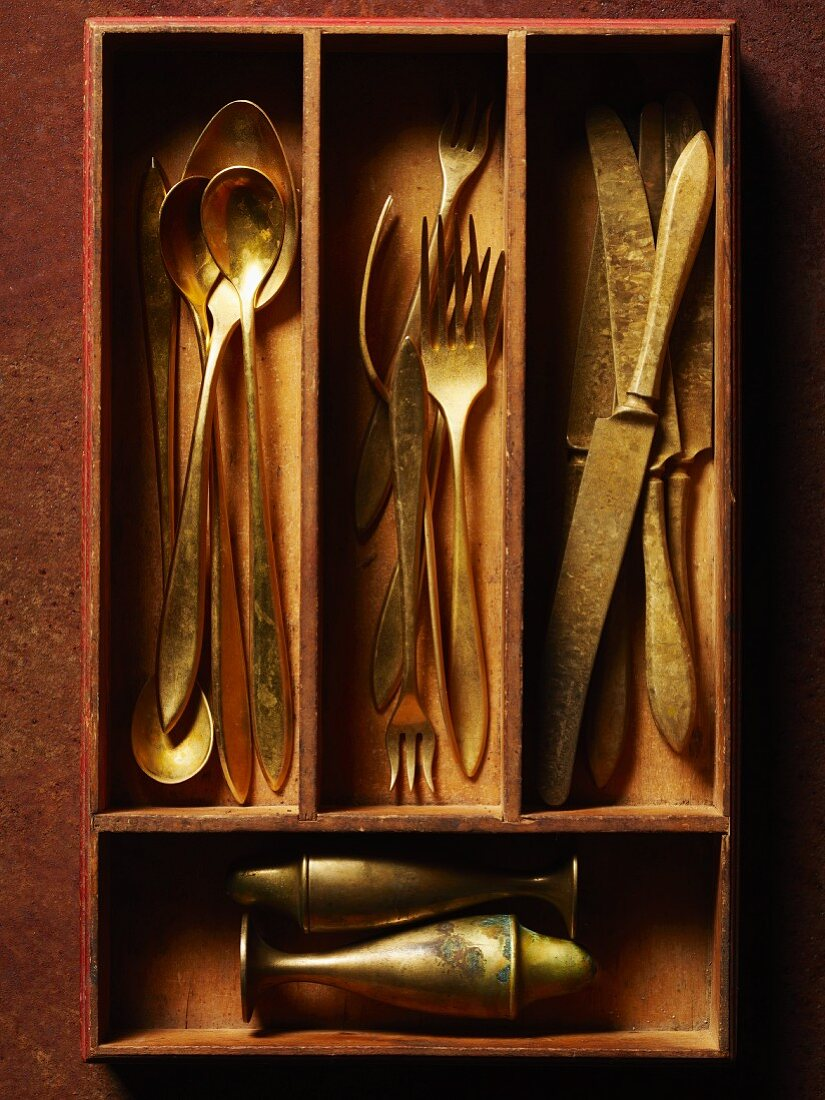 Antique Flatware in Wooden Utensil Divider; From Above