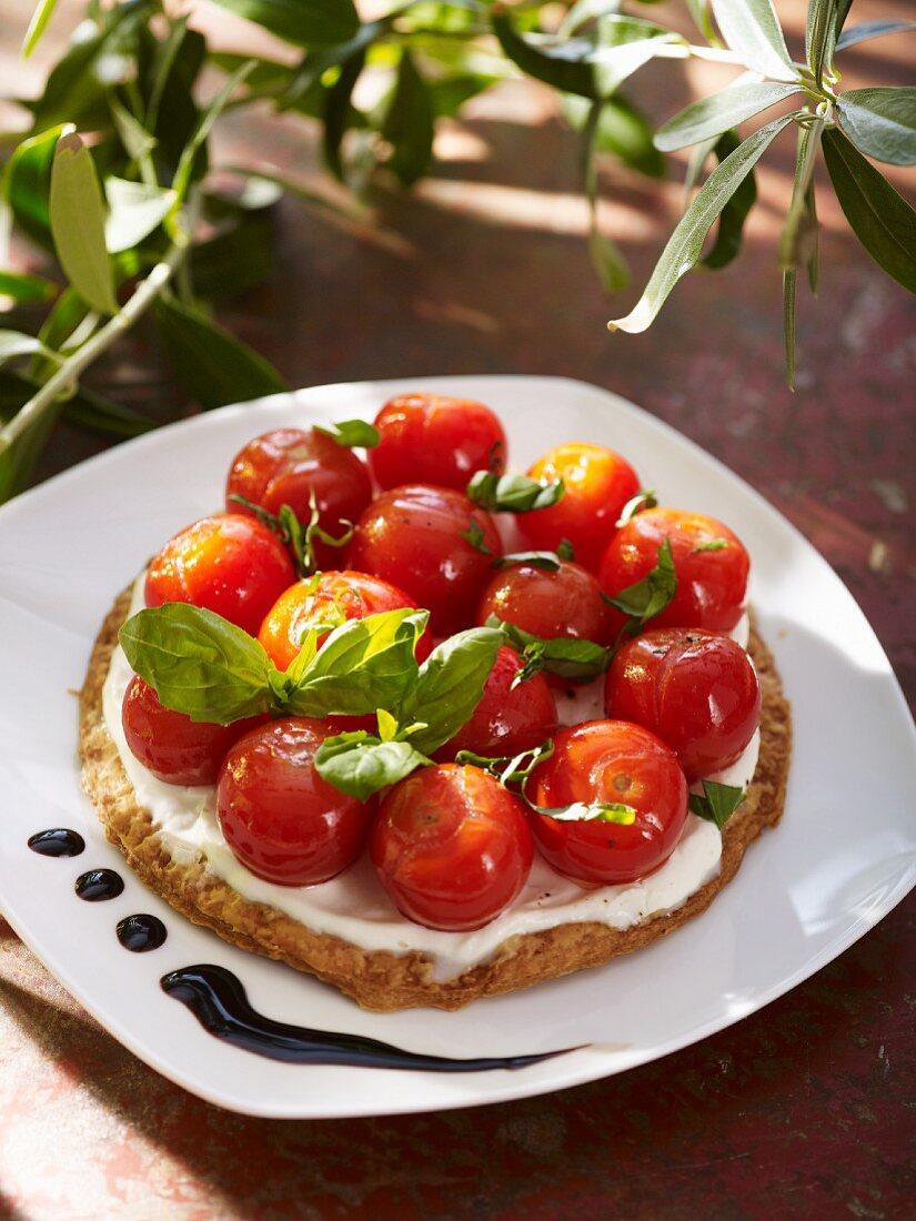 A tomato tart with mascarpone cream and basil