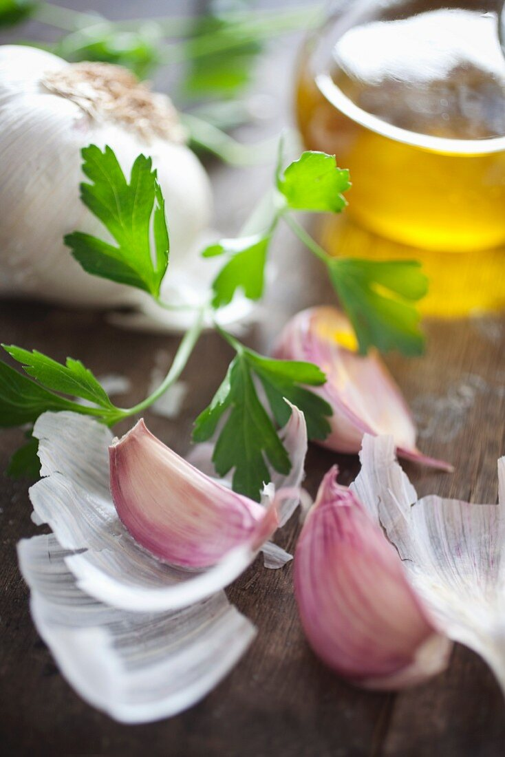 A still life of garlic, olive oil and parsley