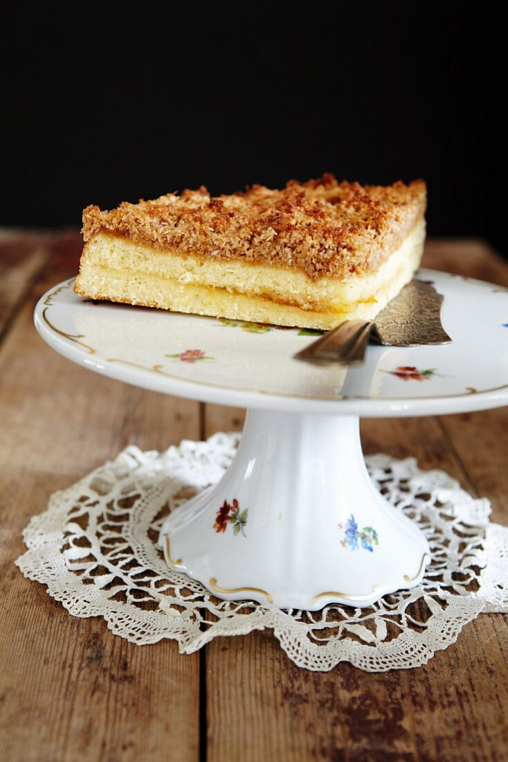 Apricot crumble cake on a torte stand