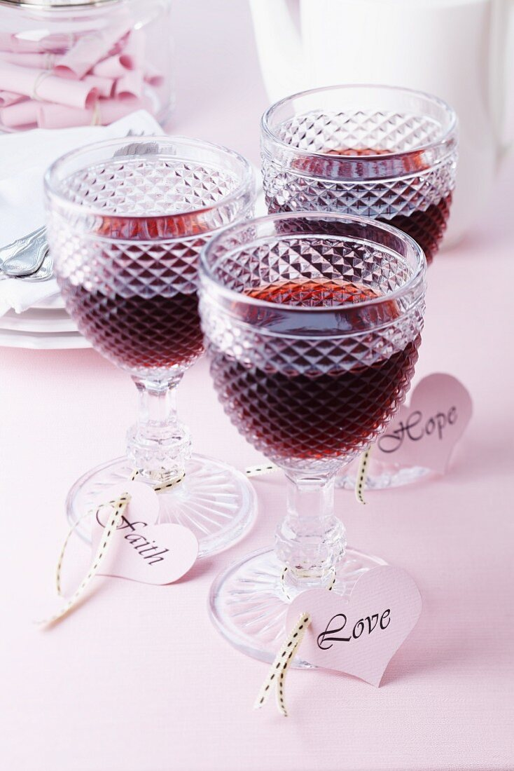Glasses of wine with heart-shaped labels