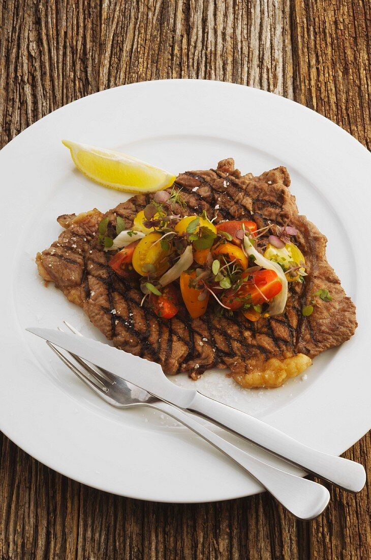 Grilled blade steak with tomato salad