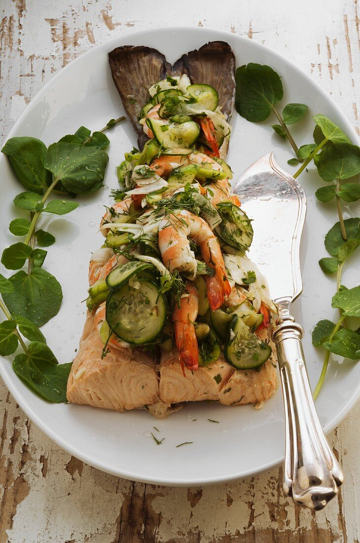 Salmon topped with king prawn and cucumber salad