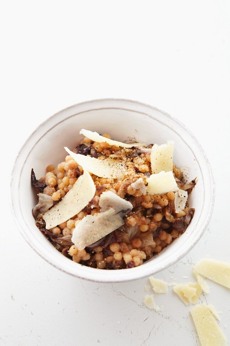 Fregola (pasta) with red endive and shaved parmesan