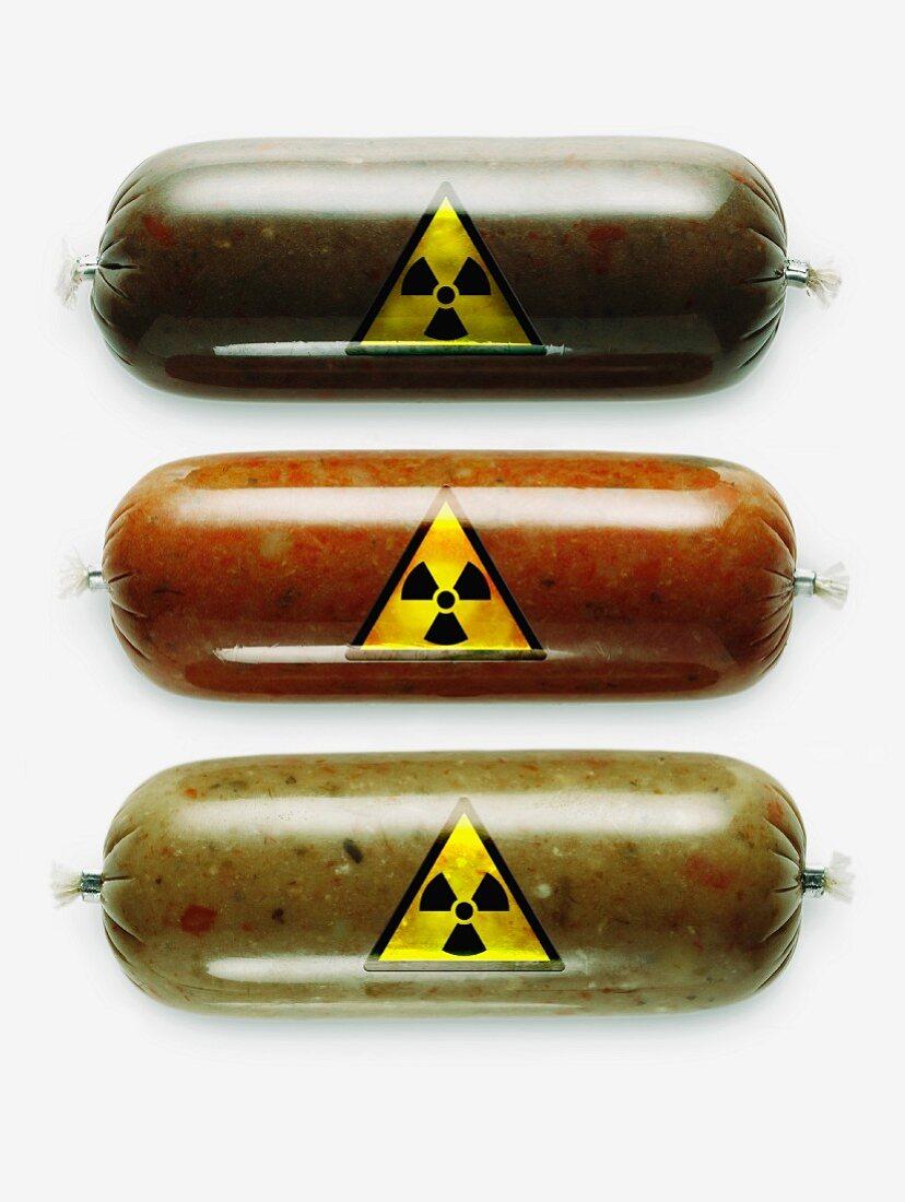Three sausages with radioactivity warning symbols