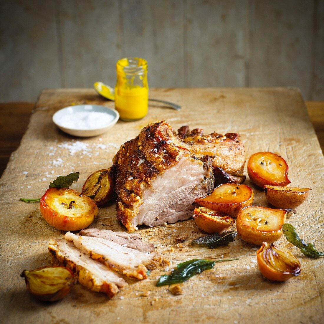 Crispy roasted pork belly with pears (partly sliced)