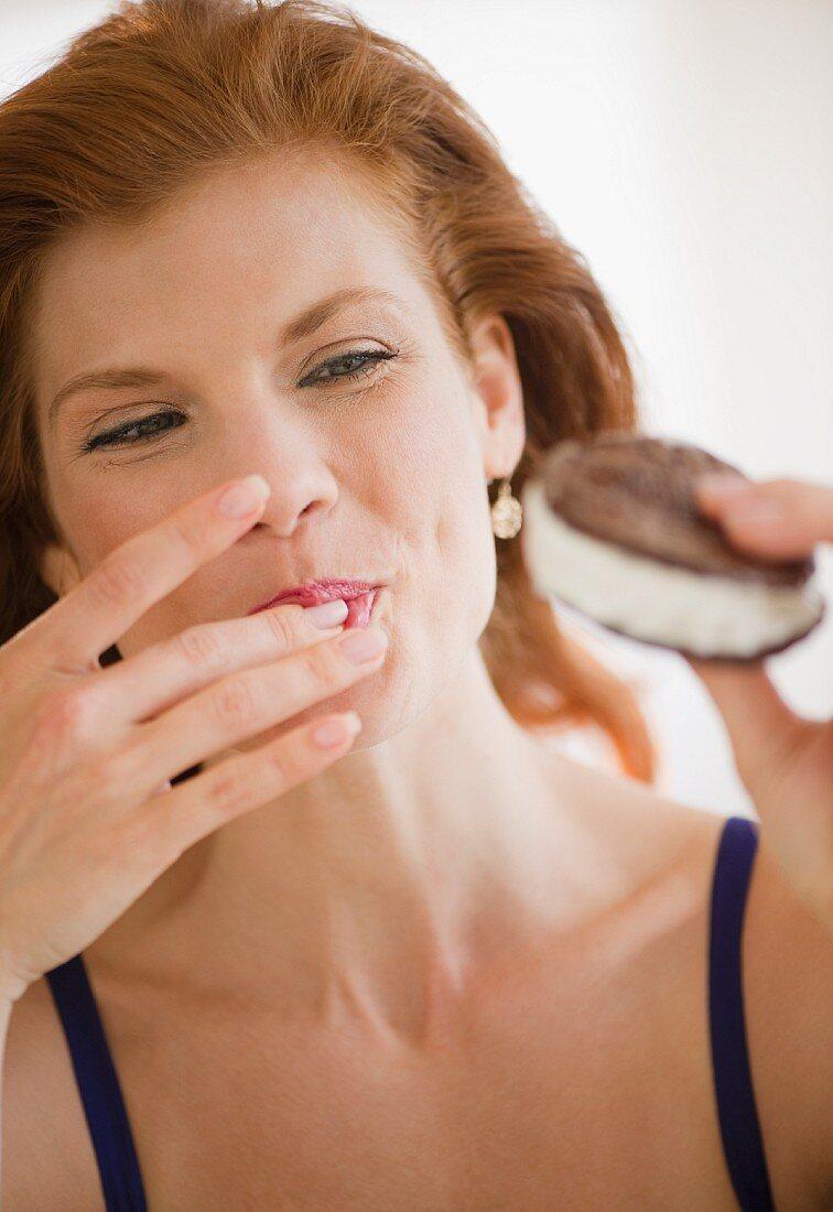 Woman eating an ice cream sandwich