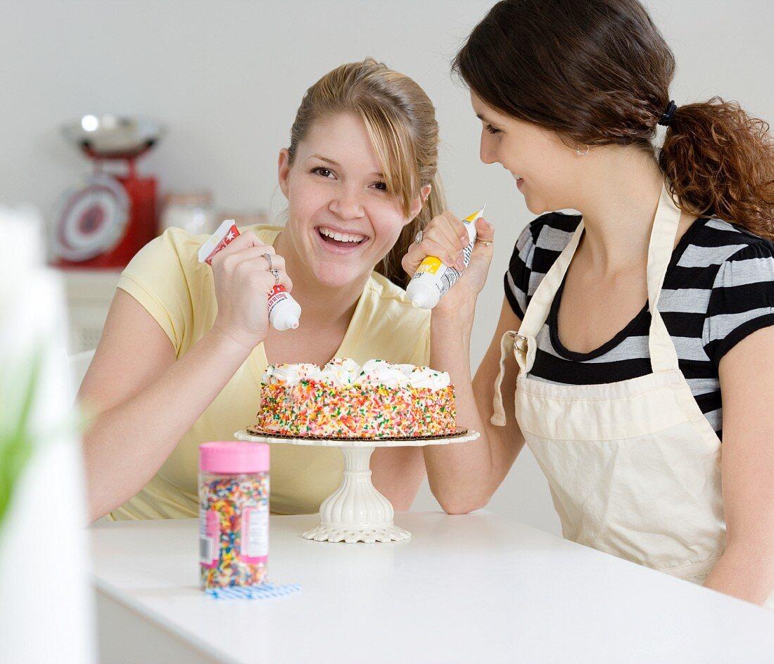 Teenage girls decorating cake
