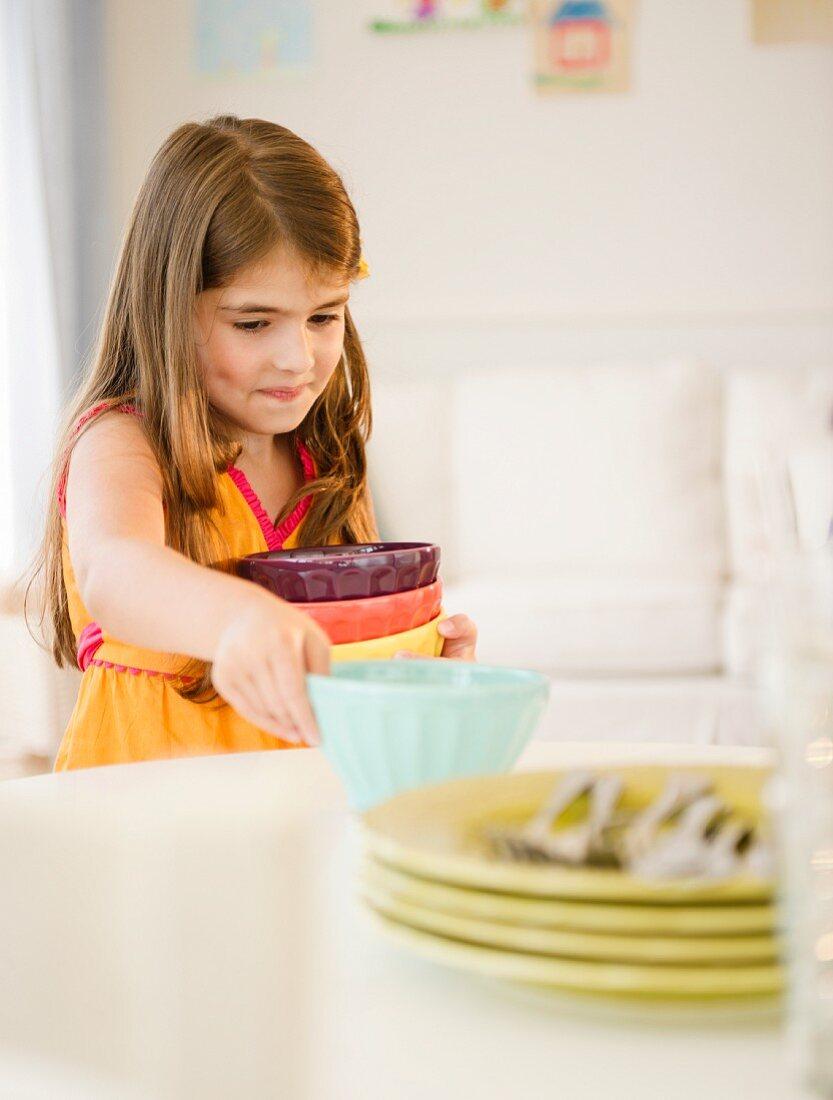 Girl ( 6-7) setting table