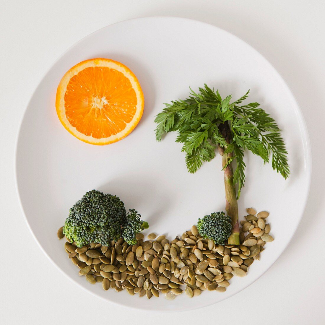 Palm tree on plate made out of food, studio shot