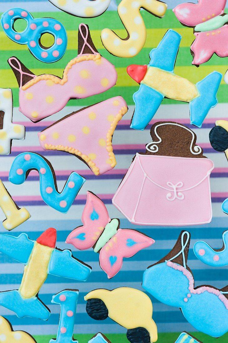 Cookies in various shapes (butterfly, bikini, handbag, airplane, numbers, car)