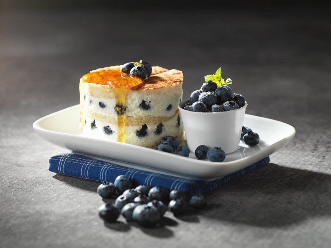 Pancake cake with quark, blueberries and honey