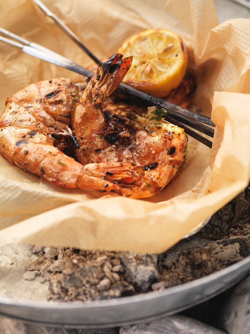 Barbecued langoustines on grease-proof paper