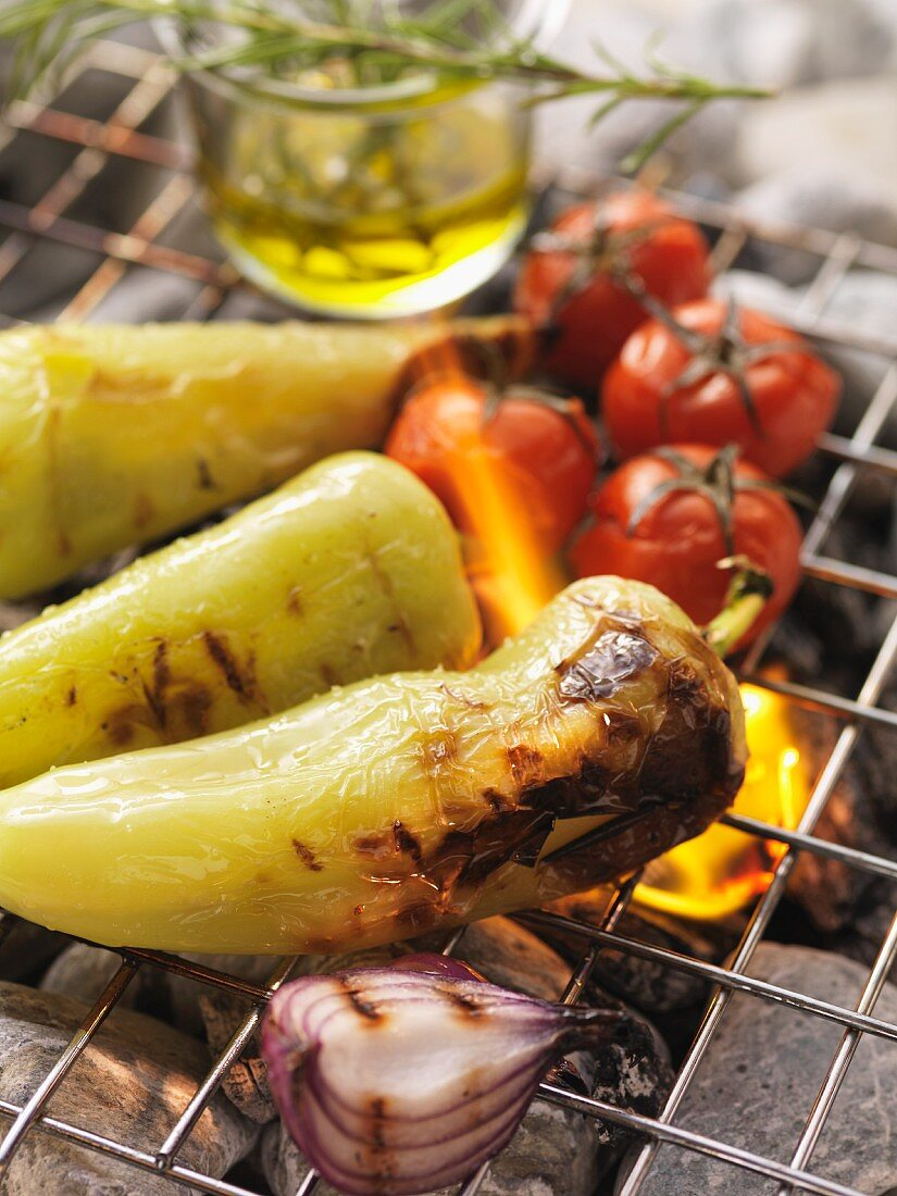 Barbecued chillies, onions and tomatoes on the barbecue