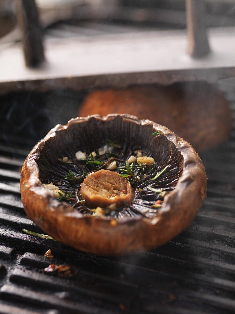 A portobello mushroom top on the barbecue