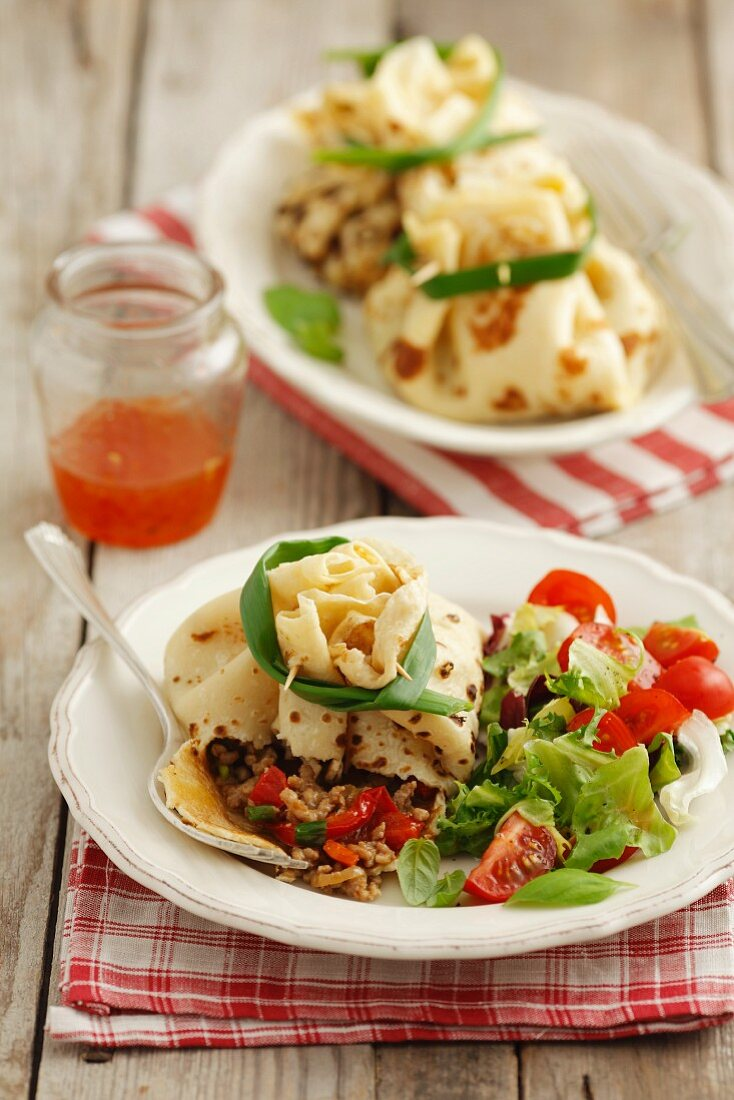 Crepe packages filled with ground beef and vegetables