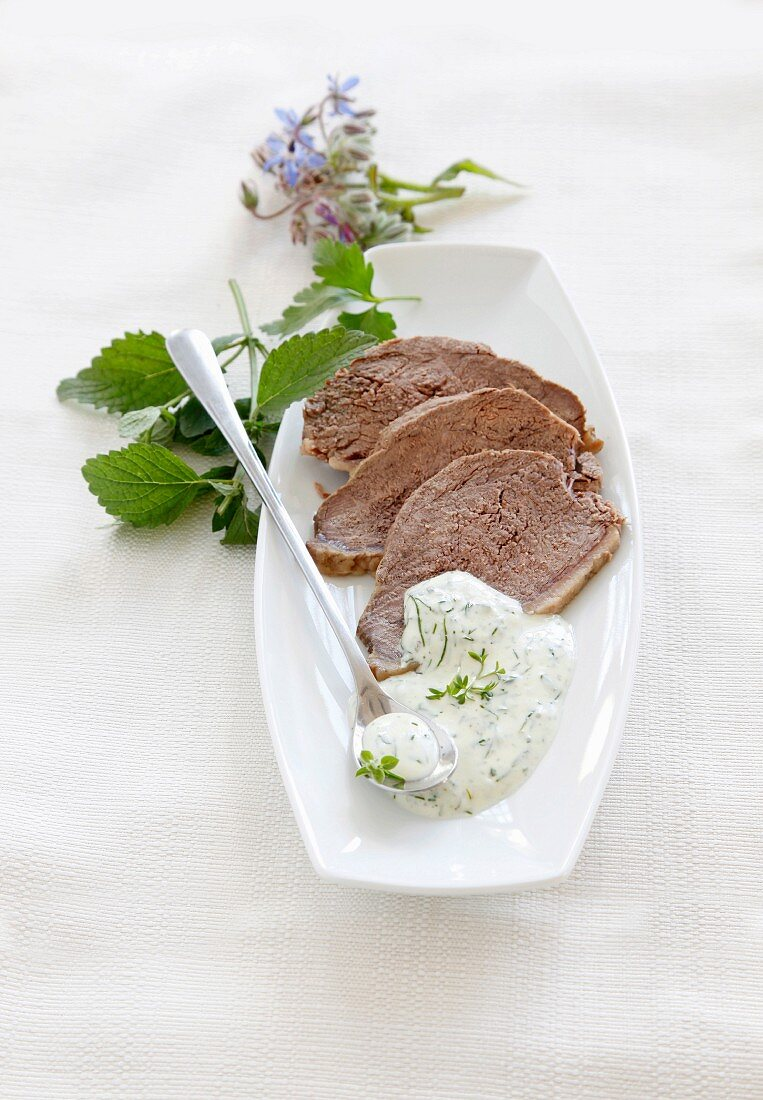 Tafelspitz (beef boiled in broth) with herb and yoghurt sauce