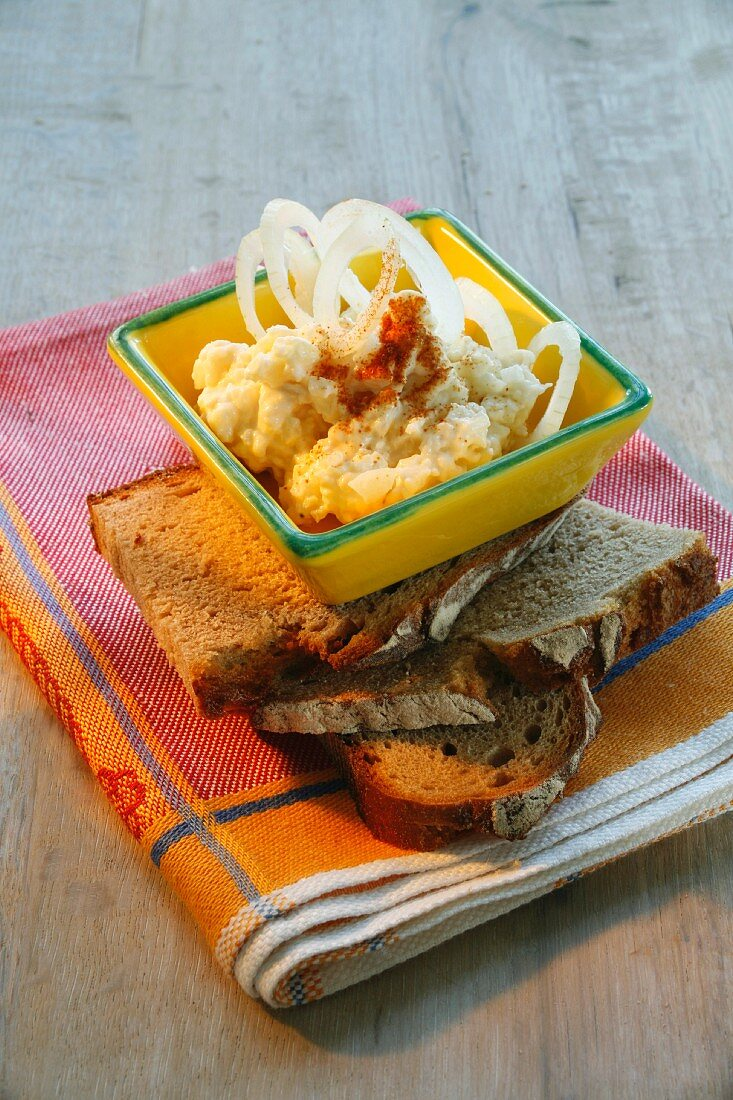 Liptauer cheese spread with onions and peppers on slices of bread