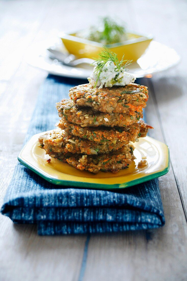 Green spelt burgers, stacked