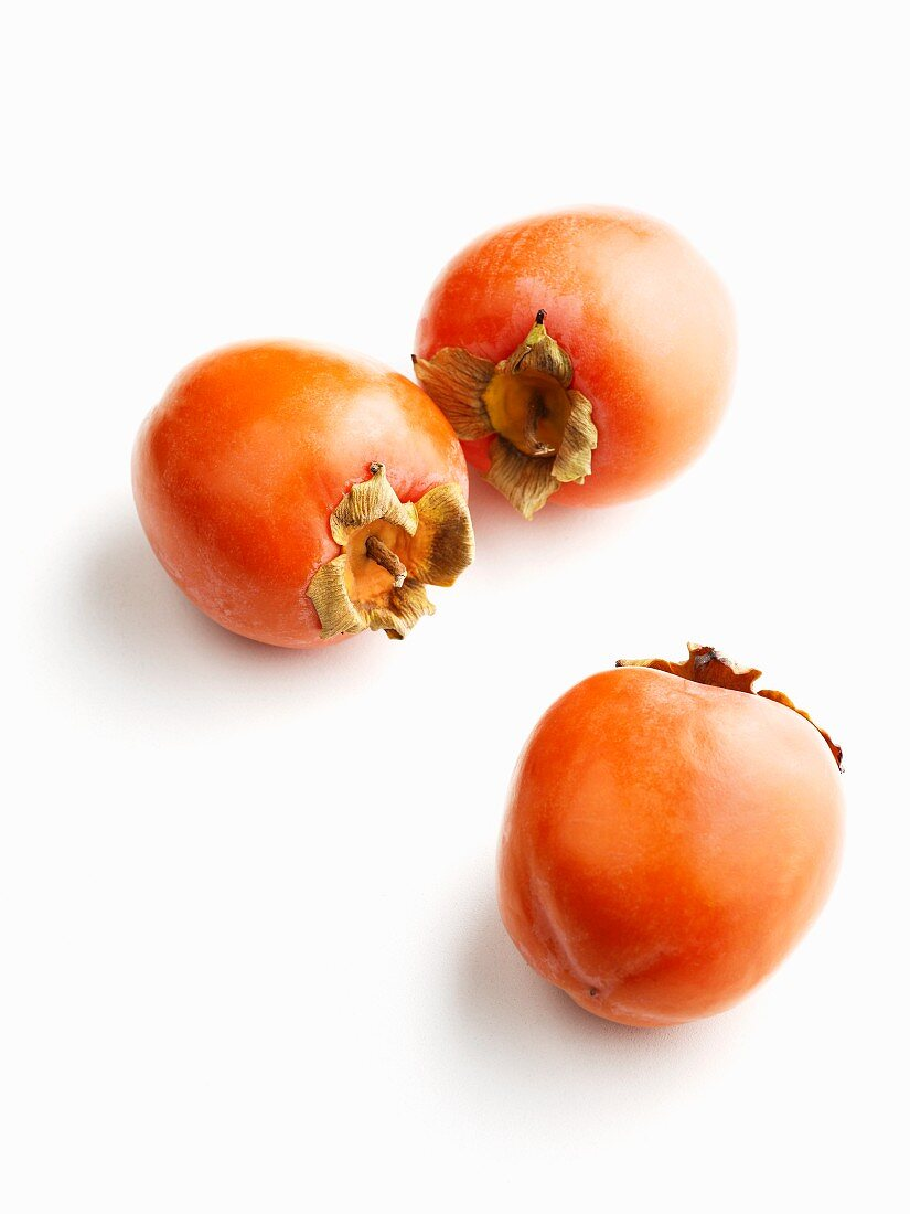 Three ripe sharon fruits