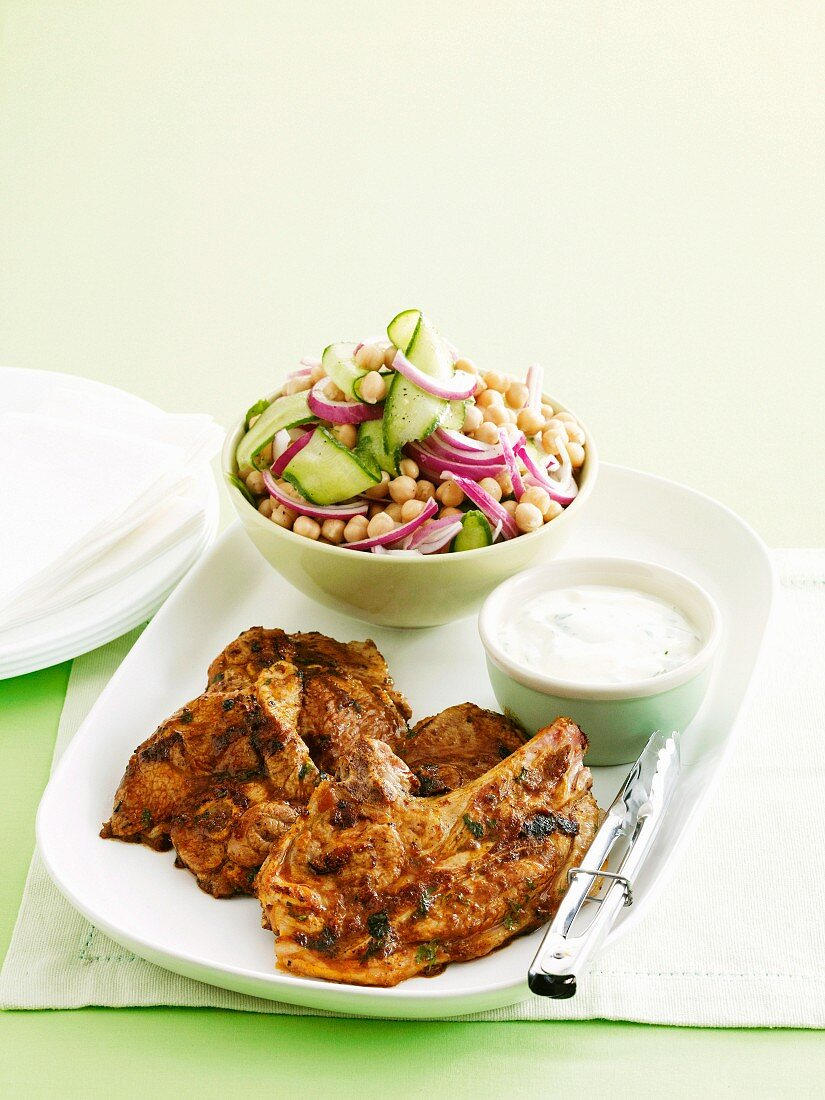 Lamb tikka masala with cucumber and chickpea salad and yoghurt sauce