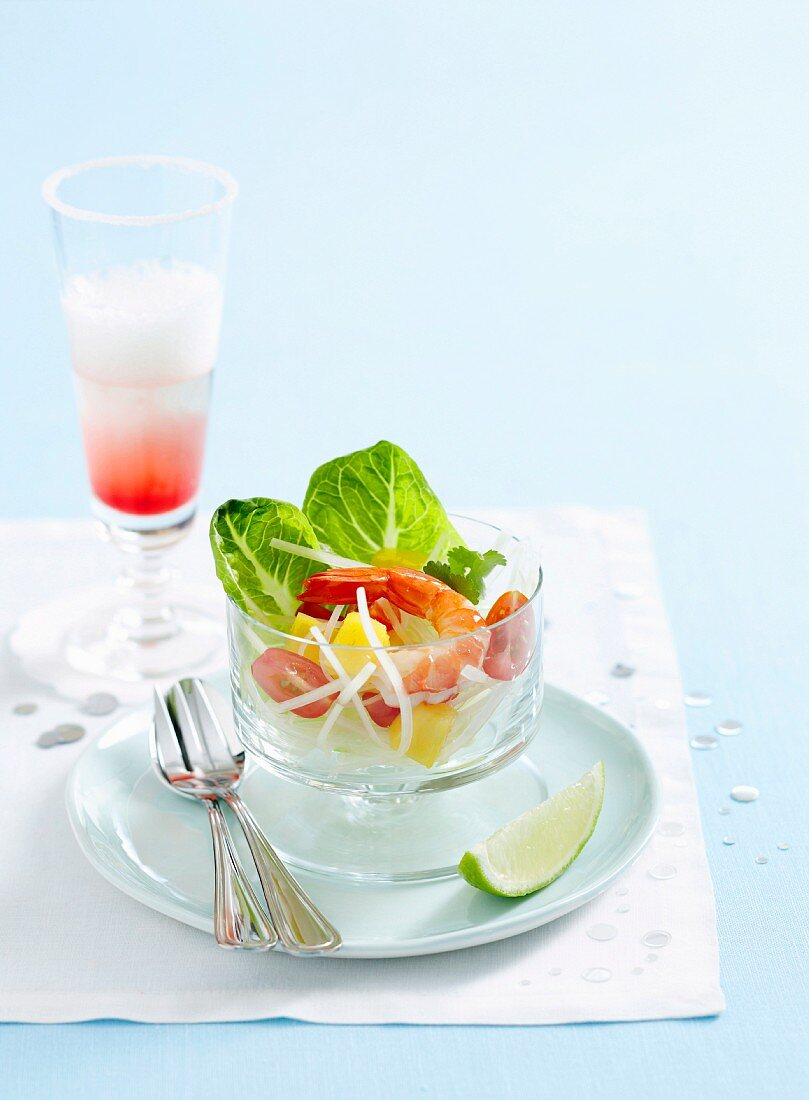 Asian salad with mango, papaya and prawns, served with a champagne and blood orange cocktail
