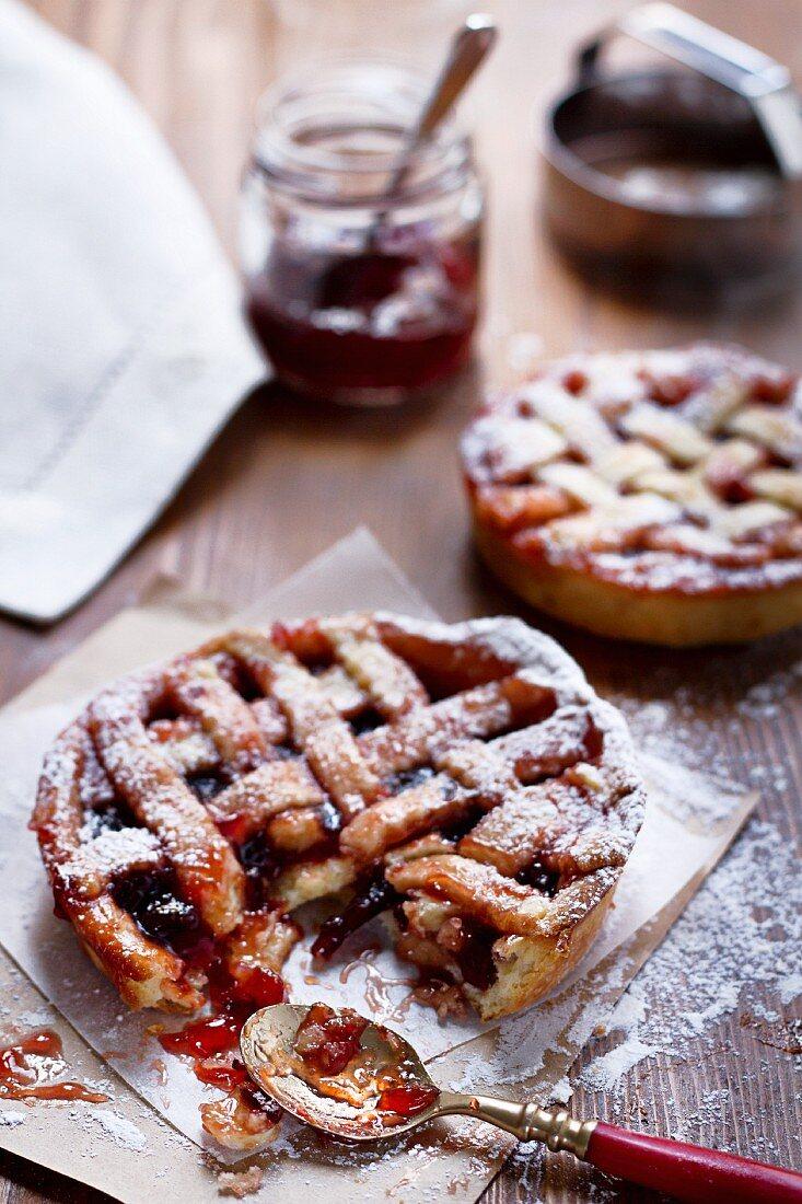 Individual shortcrust pastry tarts with plum jam