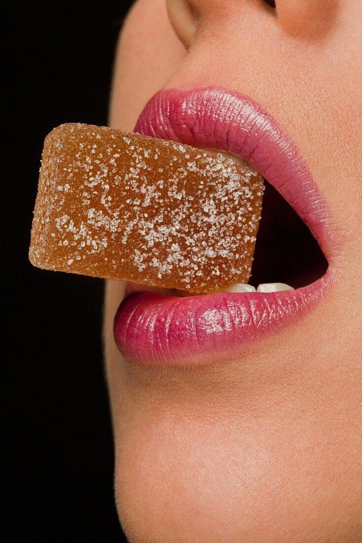 A jelly sweet held between the teeth