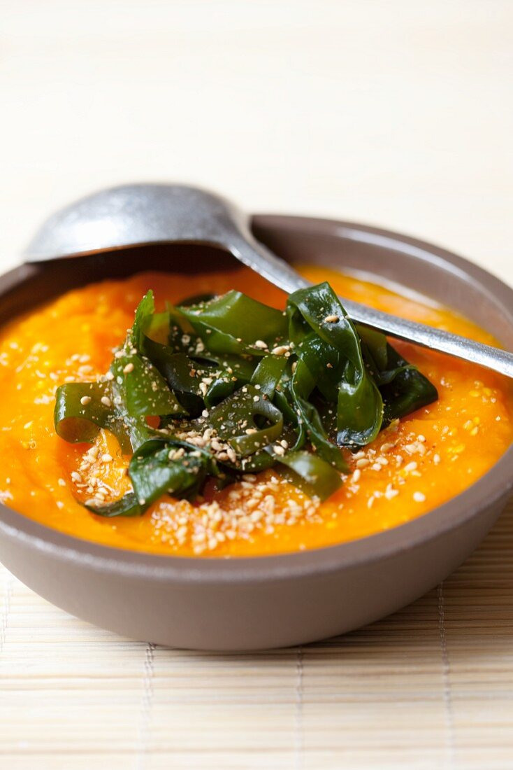Pumpkin soup with wakame and sesame seeds