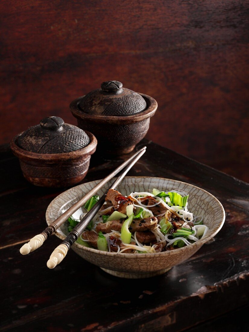 Glass noodle salad with pak choi, beef and nigella seeds