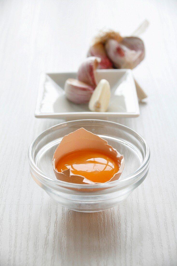 A still life of egg yolk and garlic
