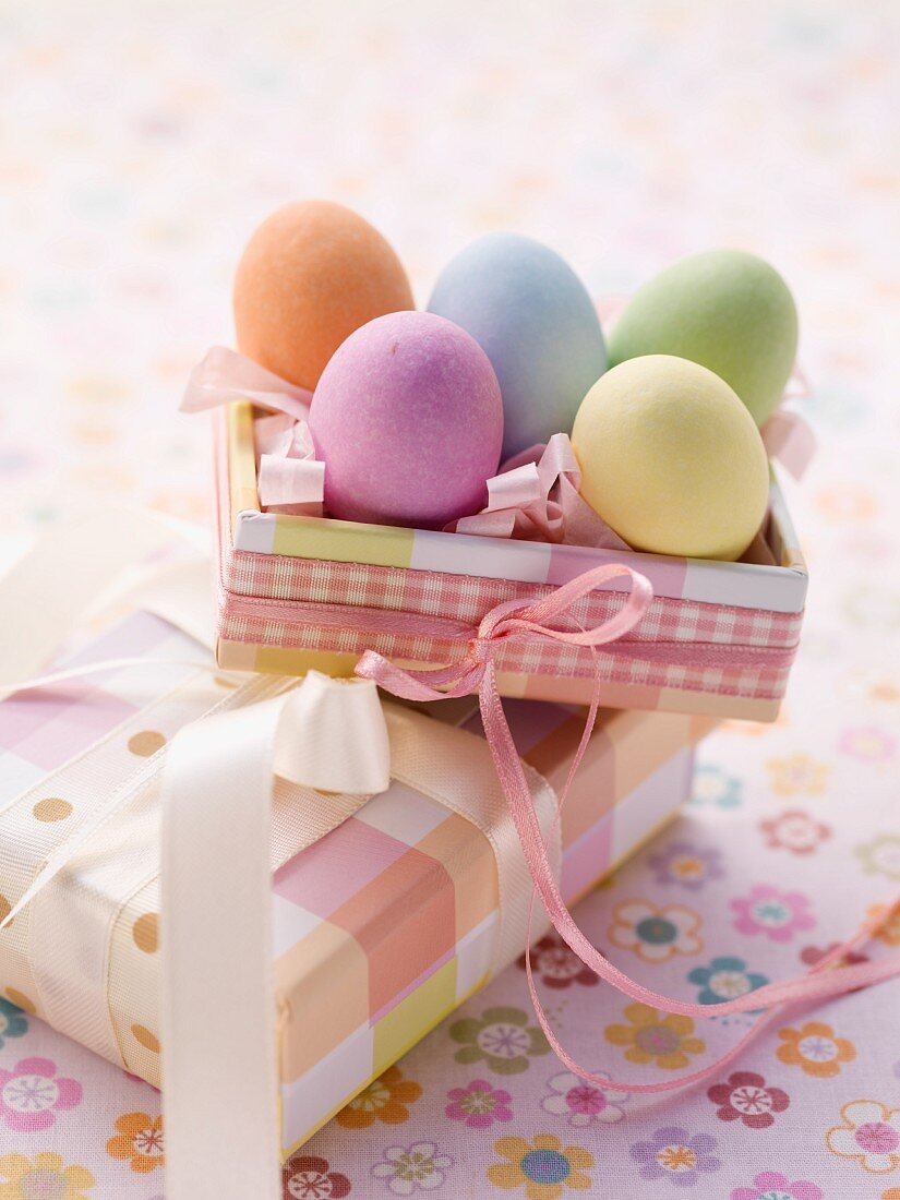 An Easter parcel and brightly coloured eggs for Easter