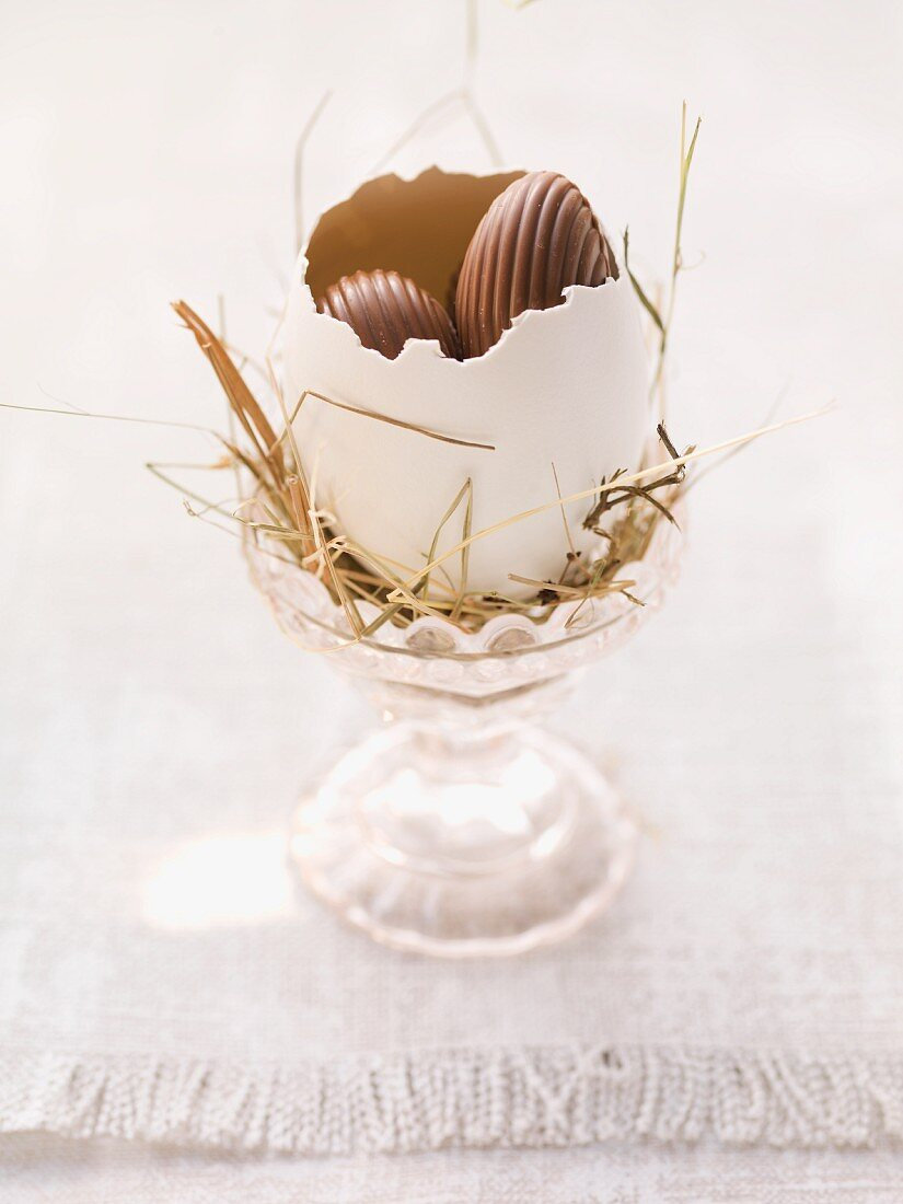 An Easter nest in an eggcup with sweets