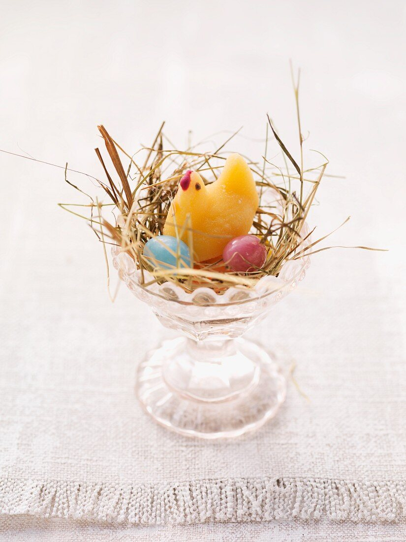 An Easter nest in an egg cup with sweets