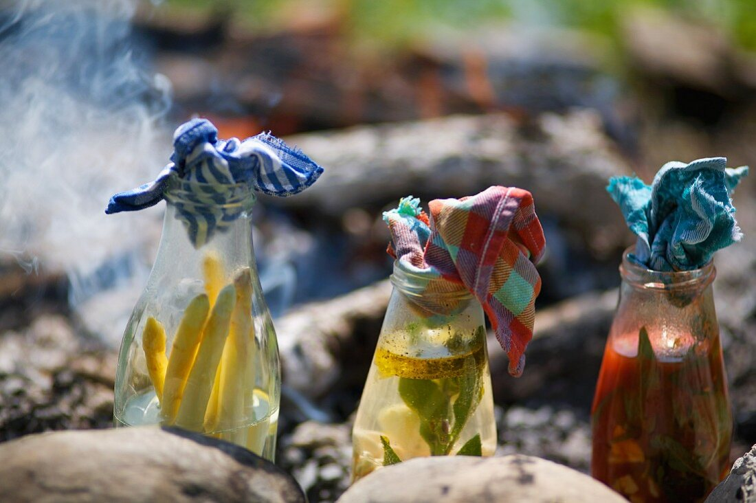 Vegetables cooked in fire-proof bottles on an open fire