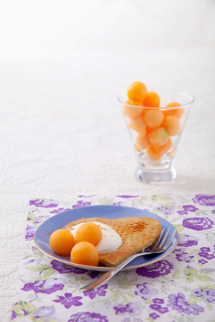 Pancake with yoghurt and melon balls
