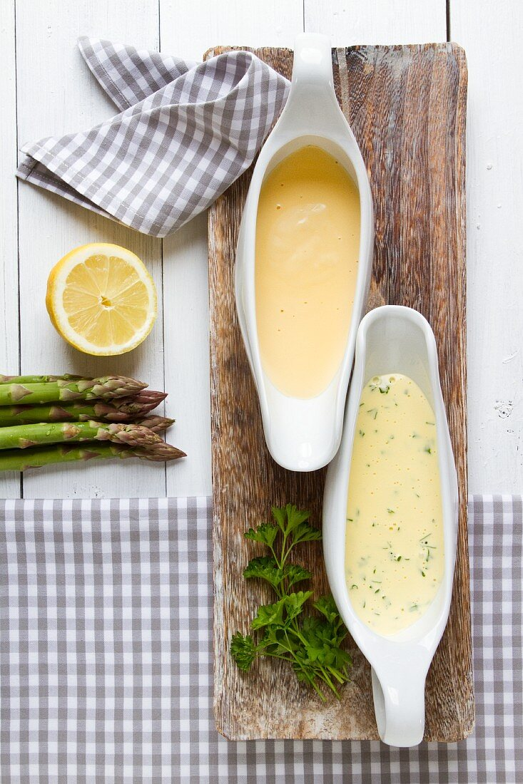 Two sauces served with asparagus