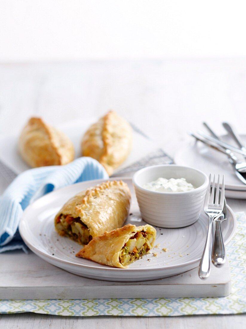 Indian vegetable pastries and raita